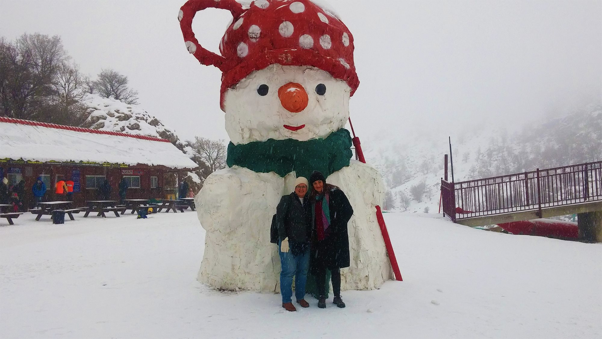 People Building A Snowman On An LDS Tour In Israel